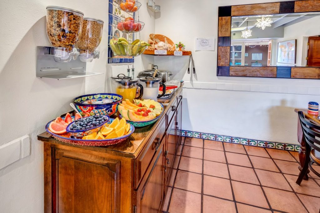 counter with fruit and pastries